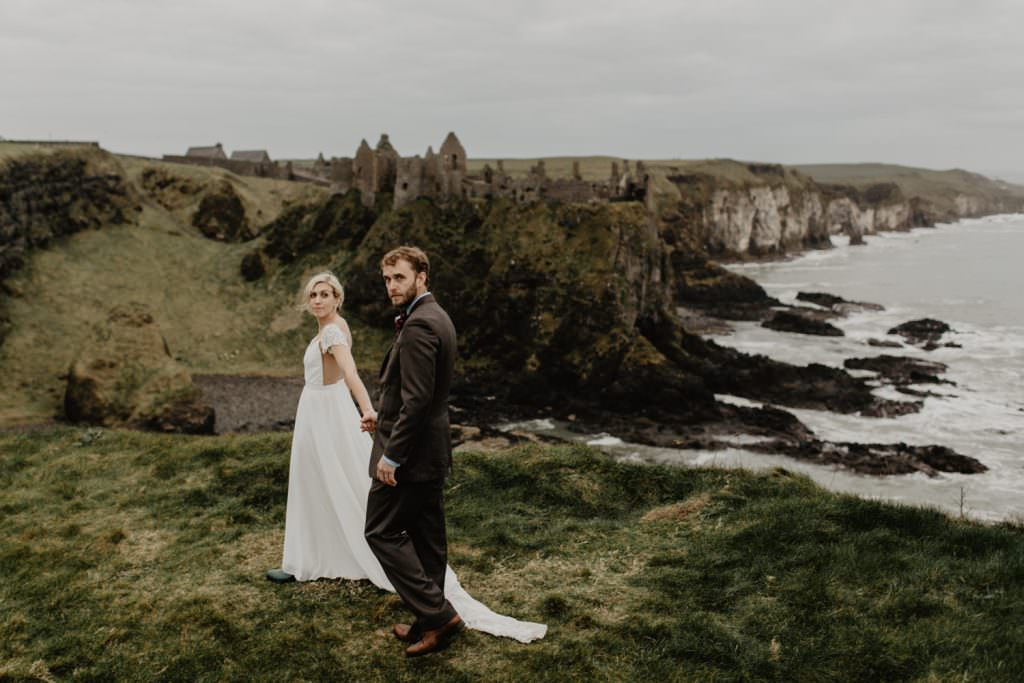 adventure elopement photographer dunluce castle northern ireland