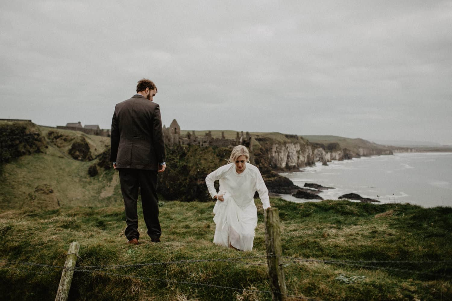 adventure elopement photographer Northern Ireland Dunluce Castle