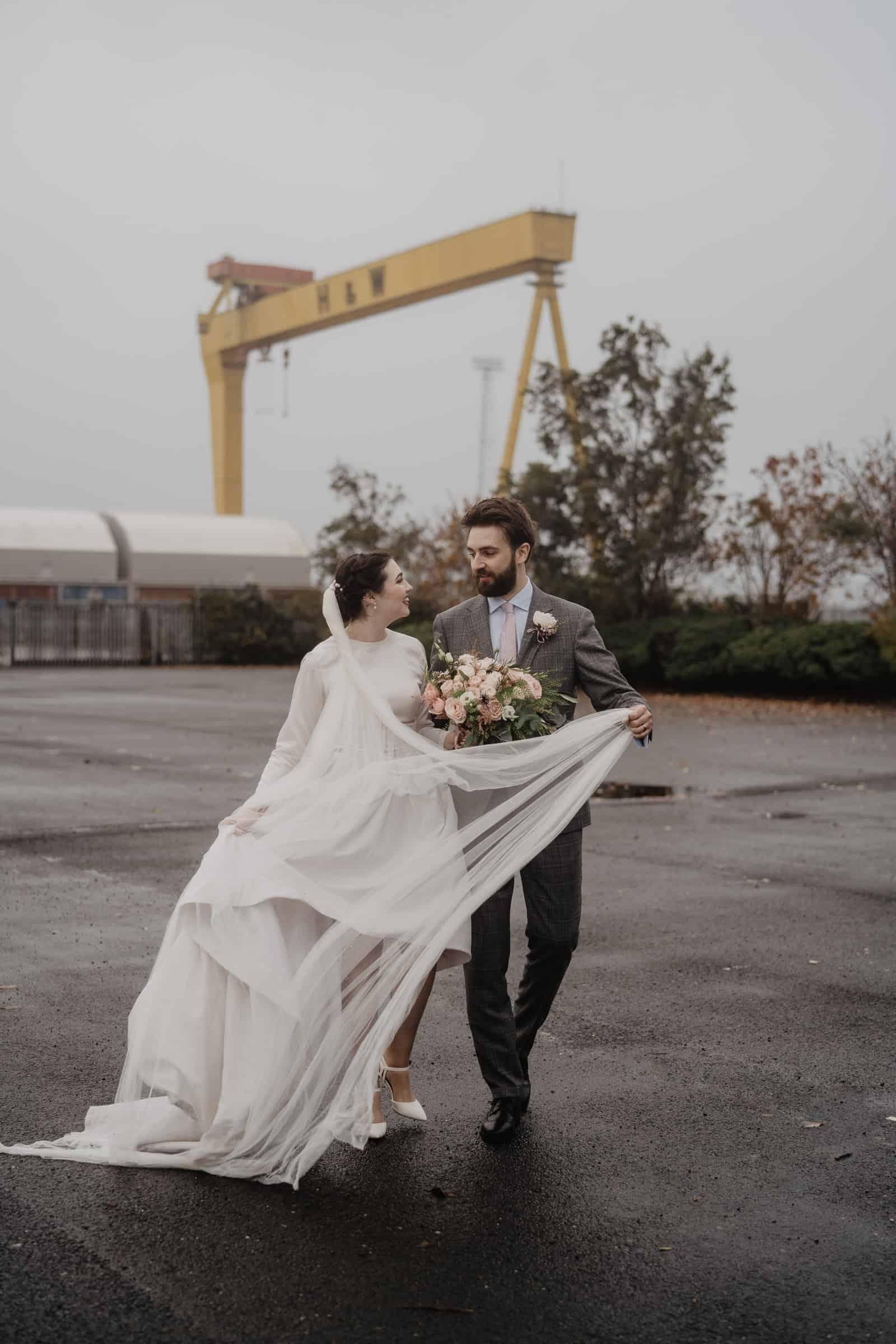 Bride and Groom outside Harland and wolf Cranes Belfast