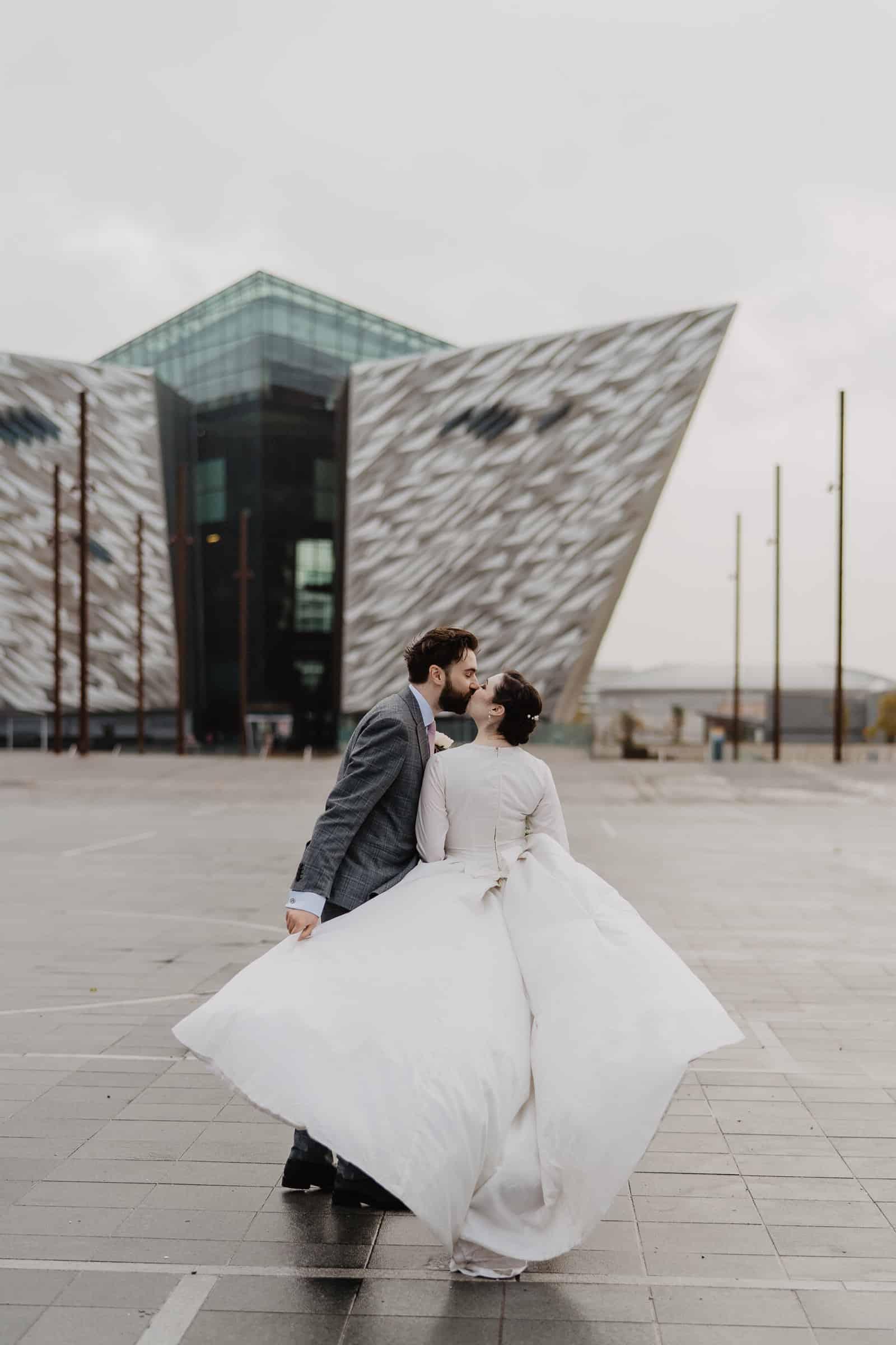 Bride and groom outside Titanic Quarter Belfast